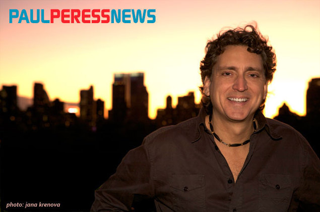 Paul Peress News... photo of Paul Peress with New York skyline in the background