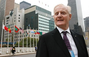 Image: Ron McCallum with different country flags behind him. Picture: Stuart Ramson Source: The Australian