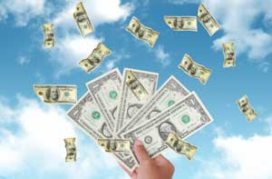 Image of money flying up in the air from outstretched hand