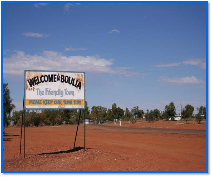 Sign saying Welcome to Boulia with desert background