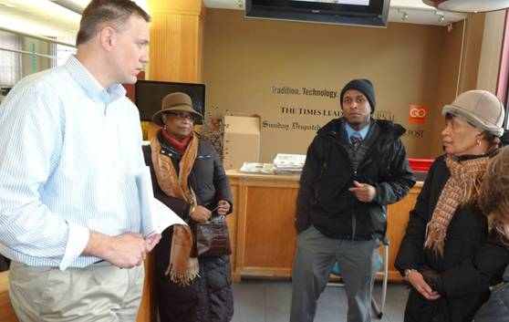 Duane Peters' family presents information to Times Leader reporter Ed Lewis at the newspapers' office.