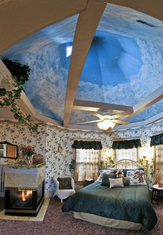 The Aspen Suite boast a Victorian turret with hand-painted sky mural over the bed