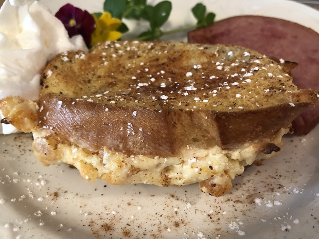 Apricot stuffed baked French toast with orange sauce
