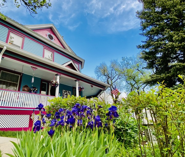 Holden House 1902 Bed & Breakfast welcome summer and irises in bloom