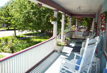 Holden House Verandah with porch swings and rocking chairs