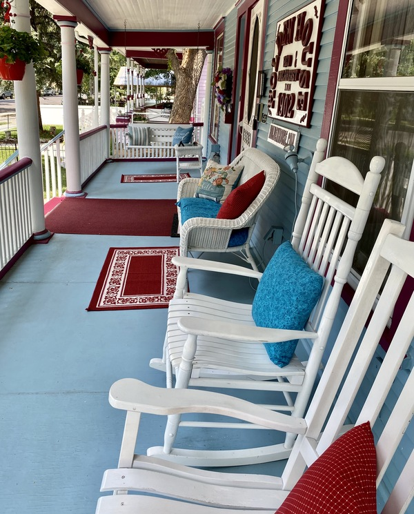 The inviting front porch with swings and rocking chairs is the perfect place to relax at Holden House