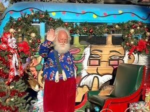 Santa Joe, Holden House' next door neighbor, brings holiday cheer to local families and kids