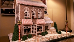 Large gingerbread bakery with sweets in winter