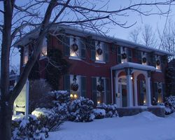 Grape Arbor in winter with snow and wreaths on windows