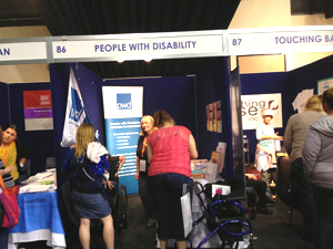 PWDA's stall and staff members at the PossABLE IDEAS Expo in Newcastle