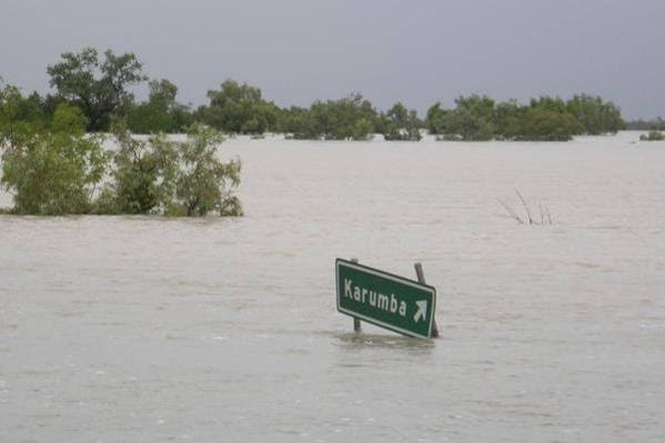 Karumba town sign sticking out of flood waters